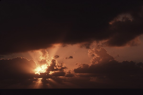 Sunset Photograph - Sunset And Clouds Over Water by Ira Block