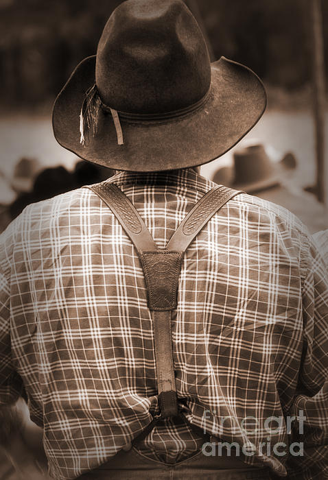 Cowboy Photograph - Suspended by Fred Lassmann