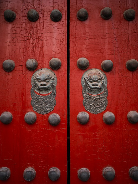 Outdoors Photograph - The Giant Red Doors To The Forbidden by Justin Guariglia
