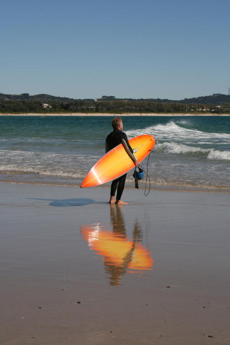 Ocean Photograph - The Orange Surfboard by Jan Lawnikanis