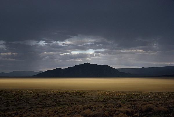 Outdoors Photograph - The Setting Sun Permeates Rain Clouds by James P. Blair