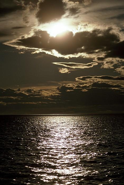 Outdoors Photograph - The Setting Sun Pierces A Menacing by Jason Edwards