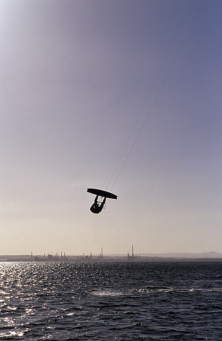Silhouette Photograph - The Silhouette Of A Person Kite by Jason Edwards