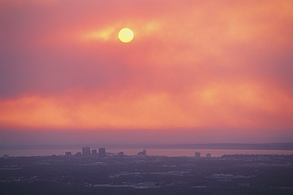 North America Photograph - This Sunset Of The Anchorage Skyline by George F. Mobley
