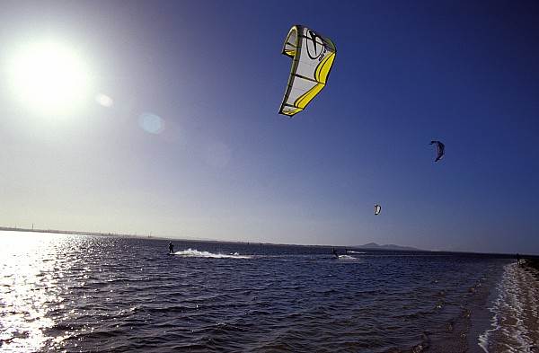 Kite Surfing Photograph - Three Kite Surfers On A Windy Summer by Jason Edwards