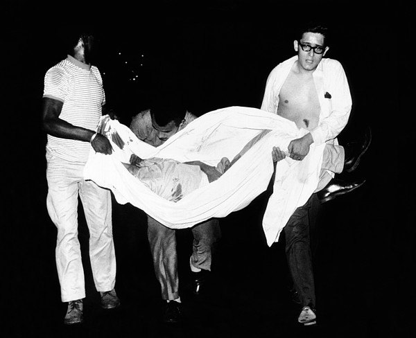 History Photograph - Three Men Carry Body Of A Youth Who by Everett