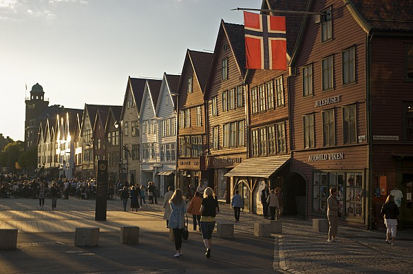 Outdoors Photograph - Tourists Walking In A Street In Bergen by Michael Melford
