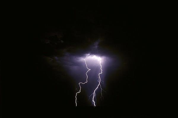 Etosha National Park Namibia Photograph - Twin Lightening Forks Slam Into A Salt by Jason Edwards