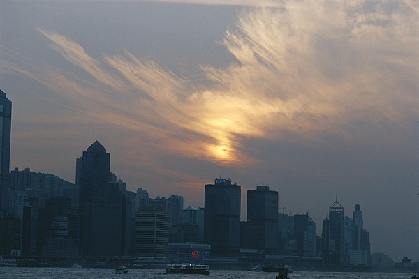 Scenes And Views Photograph - View Of The Hong Kong Skyline At Sunset by Raul Touzon