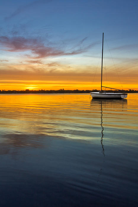 Clouds Photograph - White Boat by Debra and Dave Vanderlaan