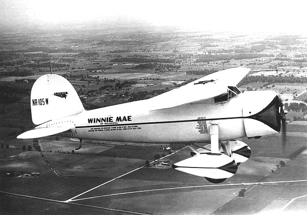 1930s Photograph - Wiley Posts Plane Winnie Mae Overhauled by Everett
