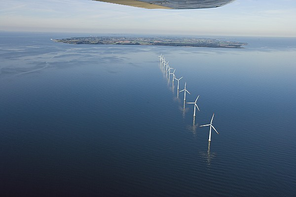 Jutland Peninsula Photograph - Wind Turbines Provide Energy by Andrew Henderson