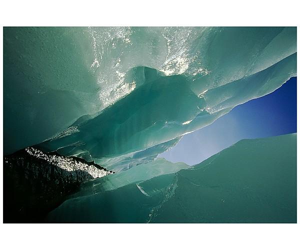Wolf Creek Photograph - Wolf Creek Flows Through Perennial Ice by Raymond Gehman