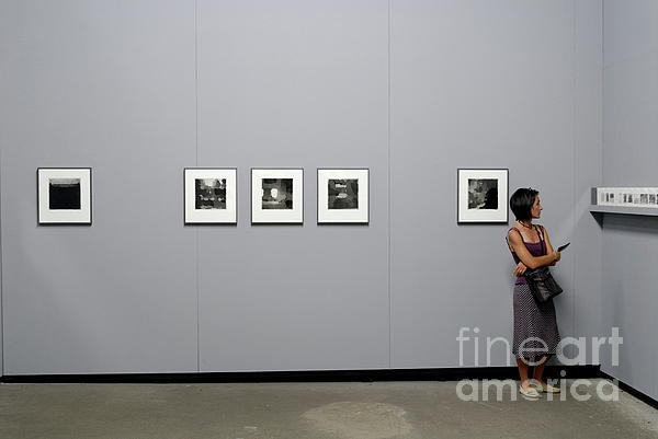 Casual Clothing Photograph - Woman Watching Photos At Exhibition by Sami Sarkis