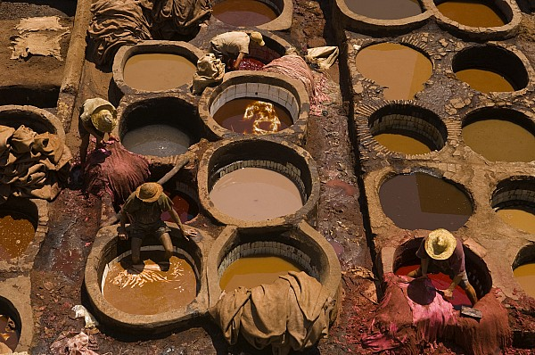 Outdoors Photograph - Workers In The Tanneries Of Fez Soak by Annie Griffiths
