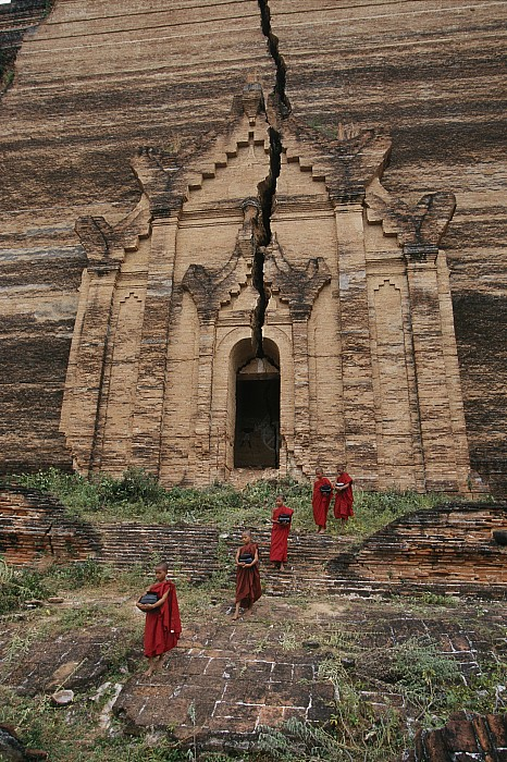 Asia Photograph - Young Buddhist Monks Near A Ruined by Paul Chesley