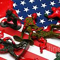 Fallen Toy Soliders On American Flag by Amy Cicconi