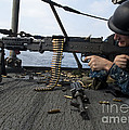 A Sailor Fires An M-240b Machine Gun by Stocktrek Images