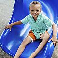 Boy On Slide by Kicka Witte