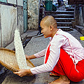 Buddhist Nun Sifting Rice