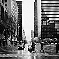 crosswalk at west georgia and hornby downtown in the rain Vancouver BC Canada by Joe Fox