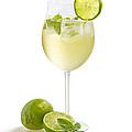 Drink With Lime And Mint In A Wine Glass by Palatia Photo
