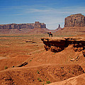 Horse and Rider in Monument Valley