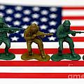 Line Of Toy Soldiers On American Flag Shallow Depth Of Field by Amy Cicconi