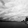 looking out from coal harbour into Vancouver Harbour on an overcast cloudy day BC Canada by Joe Fox