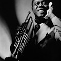 Louis Armstrong Holding A Trumpet by Anton Bruehl