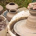Master Potter Shaping Clay by Dancasan Photography