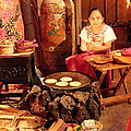 Mexican Girl Making Tortillas by Roupen  Baker