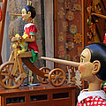 Pinocchio Inviting Tourists In Souvenirs Shop by Kiril Stanchev
