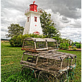 Prince Edward Island Lighthouse With Lobster Traps by Edward Fielding
