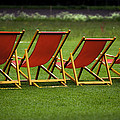 Red Deck Chairs On The Green Lawn by Mikhail Pankov