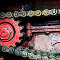 Red Gear Wheel And Chain Of Old Locomotive by Matthias Hauser
