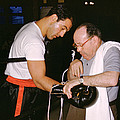 Rocky Marciano Looking At Glove by Retro Images Archive