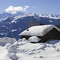 Snow-covered House In The Mountains In Winter by Matthias Hauser