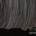 Star Trails Above A Valley by Amin Jamshidi