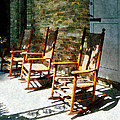 Three Wooden Rocking Chairs On Sunny Porch by Susan Savad