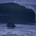 A Hippopotamus Surfs The Waves by Michael Nichols