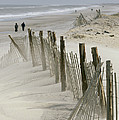 A Snow Fence Stretches Across A Dune by Skip Brown