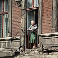 An Elderly Woman Stands At The Door by Cotton Coulson