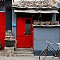 Bicycle And Red Door by Dean Harte