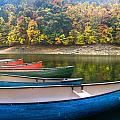 Canoes At Fontana by Debra and Dave Vanderlaan