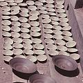 Clay Yogurt Cups Drying In The Sun by David Sherman