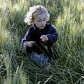 Girl Running In Wheat Field by Sami Sarkis