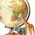 Globe With Toys Animals On White by Sandra Cunningham