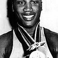 Joe Frazier Holding Olympic Heavyweight by Everett
