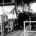 Men Wait In Line For Food by Everett